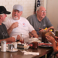 Roddy Thompson, of Pontotoc, left, talks with Morris Miller, of Tupelo, as they wait on their breakfast order at Shockley's in Tupelo Tuesday morning. Thompson and Miller are part of a group of musicians that meet at the restaurant about once a month to visit and talk music.