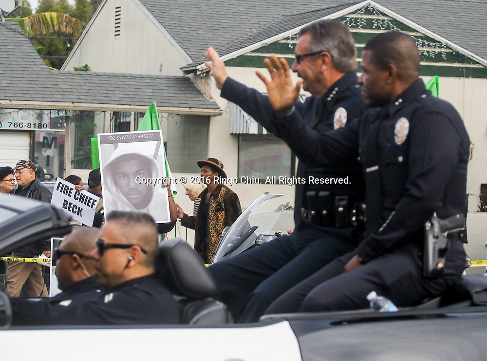 Members of Black Lives Matter protest as Los Angeles Police Chief Charlie Beck, left and Deputy Chief William Scott wave during during the Martin Luther King Jr. parade in Los Angeles on Monday Jan. 18, 2016. The 31st annual Kingdom Day Parade honoring Martin Luther King Jr. was themed &quot;Our Work Is Not Yet Done&quot;(Photo by Ringo Chiu/PHOTOFORMULA.com)<br /> <br /> Usage Notes: This content is intended for editorial use only. For other uses, additional clearances may be required.