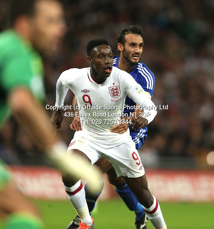 12 October 2012 Football. England v San Marino.<br /> San Marino captain Alessandro Della Valle holds on to Danny WElbeck in the penalty area.<br /> Photo: Mark Leech.