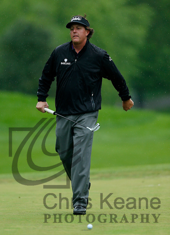 Phil Mickelson of the U.S. reacts after missing his birdie putt on the 15th hole during the final round of the Wells Fargo Championship at the Quail Hollow Club in Charlotte, North Carolina on May 5, 2013.  (Photo by Chris Keane - www.chriskeane.com)