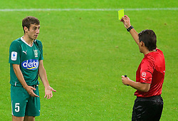 Boban Jovic of Olimpija and referee Roberto Ponis with yellow card during the football match between NK Olimpija and HIT Gorica, played in the 11th Round of Prva liga football league 2010 - 2011, on September 25, 2010, SRC Stozice, Ljubljana, Slovenia. (Photo by Vid Ponikvar / Sportida)