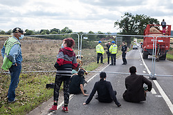 Offchurch, UK. 24th August, 2020. Anti-HS2 activists observe fellow activists who had occupied three mature oak trees and a trailer transporting wood chip in order to try to prevent or delay tree felling alongside the Fosse Way in connection with the HS2 high-speed rail link. The controversial HS2 infrastructure project is currently expected to cost £106bn and will destroy or significantly impact many irreplaceable natural habitats, including 108 ancient woodlands.