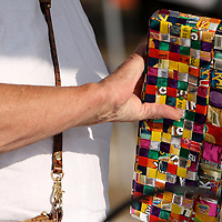 A festival-goer looks at a purse at Playful Expressions during the Town of Leland's Founder's Day festival.