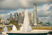 Water fountains and Punta Paitilla condominiums on background. Cinta Costera bayside road, Panama City, Panama, Central America.