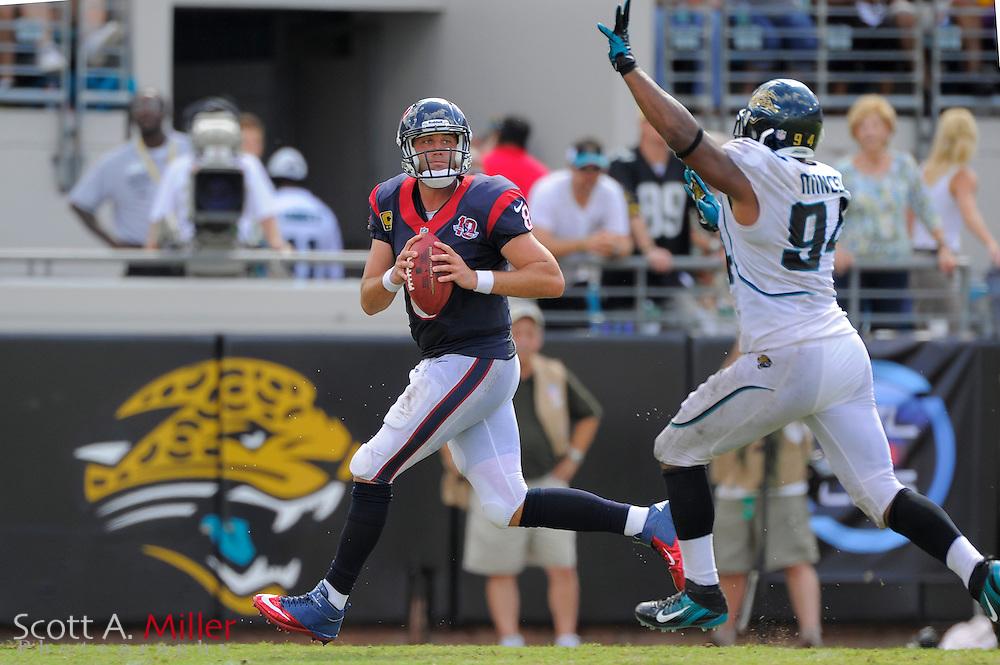 Houston Texans quarterback Matt Schaub (8) is pressured by Jacksonville Jaguars defensive end Jeremy Mincey (94) during the Texans 27-7 win at EverBank Field on September 16, 2012 in Jacksonville, Florida. ..©2012 Scott A. Miller..