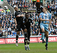 Photo: Steve Bond/Richard Lane Photography.<br />Coventry City v Chelsea. FA Cup 6th Round. 07/03/2009. Ben Turner (L) heads for goal. Alex, Michael Essien and Didier Drogba defend