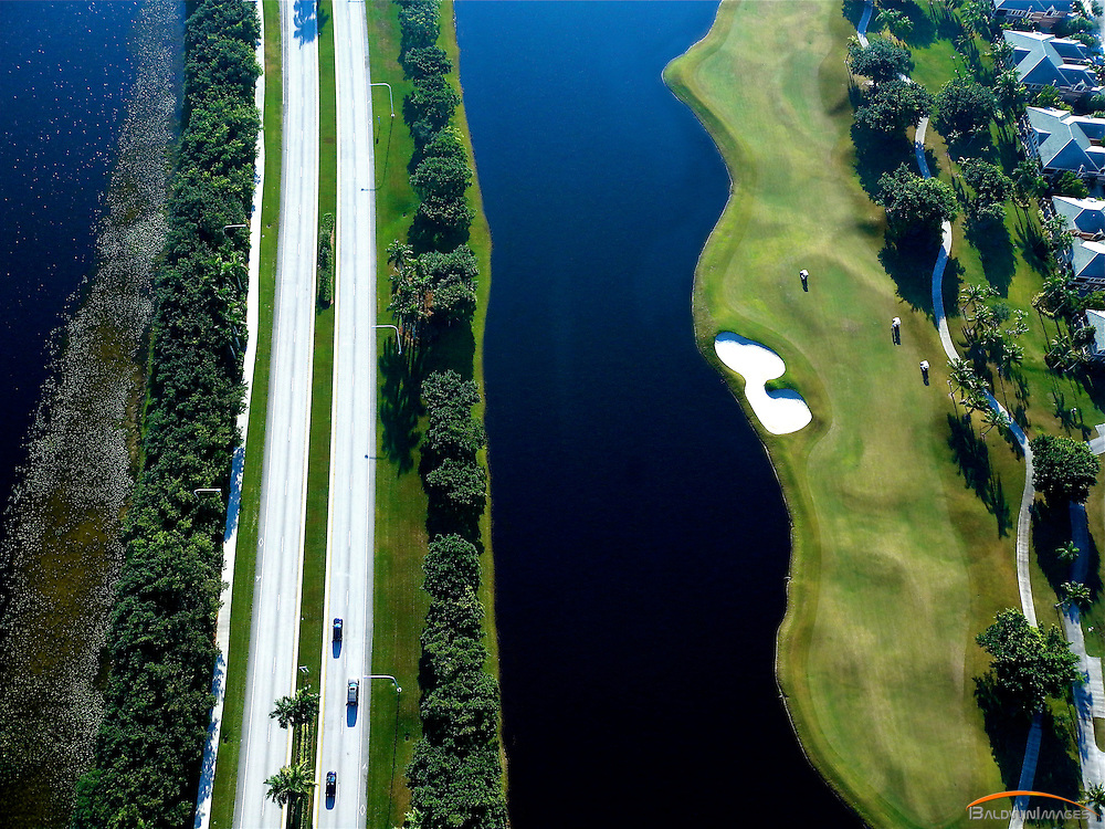 Aerial view of main road and golf course in Weston Fl, surrounded by lakes