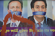 Splashed paint drips down an anti-EU membership 'UK Independence Party's (UKIP) political billboard shows a gagged Prime Minister David Cameron and Labour party leader Ed Milliband - both silent against a bullying European Union, seen in East Dulwich - a relatively affluent district of south London. The ad is displayed before European elections on 22nd May.