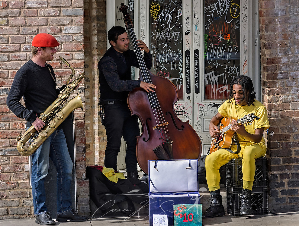 A jazz band performs on a street corner, November 11, 2015, in New Orleans, Louisiana. (Photo by Carmen K. Sisson/Cloudybright)