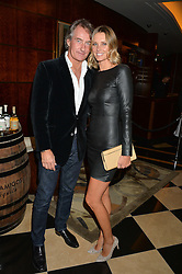 TIM & MALIN JEFFERIES at the London launch of Casamigos Tequila hosted by Rande Gerber, George Clooney & Michael Meldman and to celebrate Cindy Crawford's new book 'Becoming' held at The Beaumont Hotel, Brown Hart Gardens, 8 Balderton Street, London on 1st October 2015.