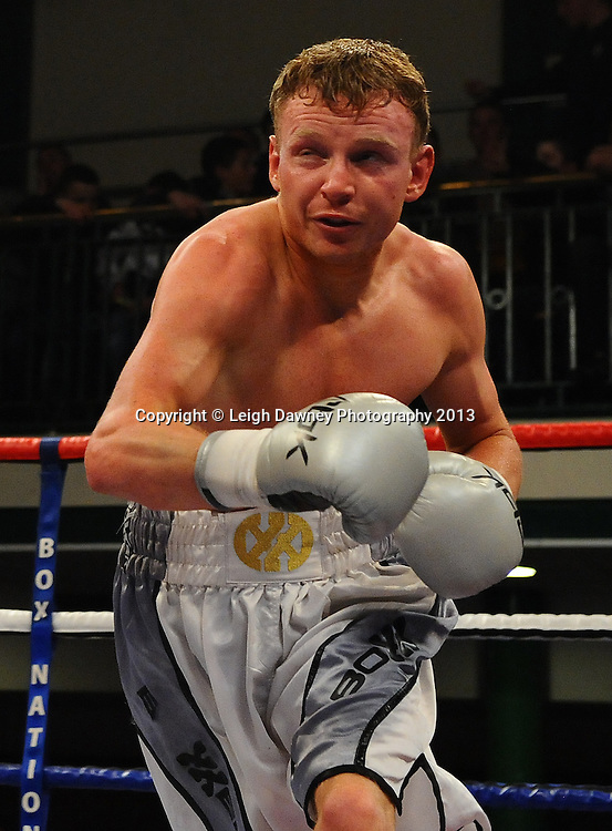 Billy Morgan (claret/blue) defeats Dan Carr at York Hall, Bethnal Green, London, UK on the 21st March 2013. Frank Warren Promotions. © Leigh Dawney Photography 2013.