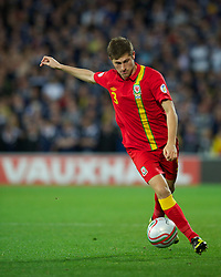 CARDIFF, WALES - Friday, October 12, 2012: Wales' Ben Davies in action against Scotland during the Brazil 2014 FIFA World Cup Qualifying Group A match at the Cardiff City Stadium. (Pic by David Rawcliffe/Propaganda)