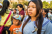"30 JANUARY 2013 - PHNOM PENH, CAMBODIA:    A woman wearing a pin honoring King Sihanouk stops in front of the National Museum in Phnom Penh to look at the cremation site for late Cambodian King Norodom Sihanouk. Sihanouk (31 October 1922 - 15 October 2012) was the King of Cambodia from 1941 to 1955 and again from 1993 to 2004. He was the effective ruler of Cambodia from 1953 to 1970. After his second abdication in 2004, he was given the honorific of ""The King-Father of Cambodia."" Sihanouk held so many positions since 1941 that the Guinness Book of World Records identifies him as the politician who has served the world's greatest variety of political offices. These included two terms as king, two as sovereign prince, one as president, two as prime minister, as well as numerous positions as leader of various governments-in-exile. He served as puppet head of state for the Khmer Rouge government in 1975-1976. Most of these positions were only honorific, including the last position as constitutional king of Cambodia. Sihanouk's actual period of effective rule over Cambodia was from 9 November 1953, when Cambodia gained its independence from France, until 18 March 1970, when General Lon Nol and the National Assembly deposed him. Upon his final abdication, the Cambodian throne council appointed Norodom Sihamoni, one of Sihanouk's sons, as the new king. Sihanouk died in Beijing, China, where he was receiving medical care, on Oct. 15, 2012. His cremation is scheduled to take place on Feb. 4, 2013. Over a million people are expected to attend the service.        PHOTO BY JACK KURTZ"