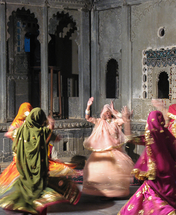 Women dancing at a square in the town of Jaisalmer, India