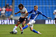 Ryan Shotton (5) of Middlesbrough is challenged by Danny Ward (23) of Cardiff City during the EFL Sky Bet Championship match between Cardiff City and Middlesbrough at the Cardiff City Stadium, Cardiff, Wales on 21 September 2019.