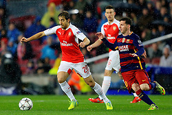 Arsenal's Mathieu Flamini is chased by Lionel Messi of Barcelona  - Mandatory byline: Matt McNulty/JMP - 16/03/2016 - FOOTBALL - Nou Camp - Barcelona,  - FC Barcelona v Arsenal - Champions League - Round of 16