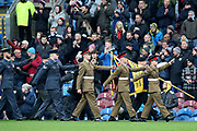 Colour Party lead the teams out for the minutes silence during the Premier League match between Burnley and West Ham United at Turf Moor, Burnley, England on 9 November 2019.