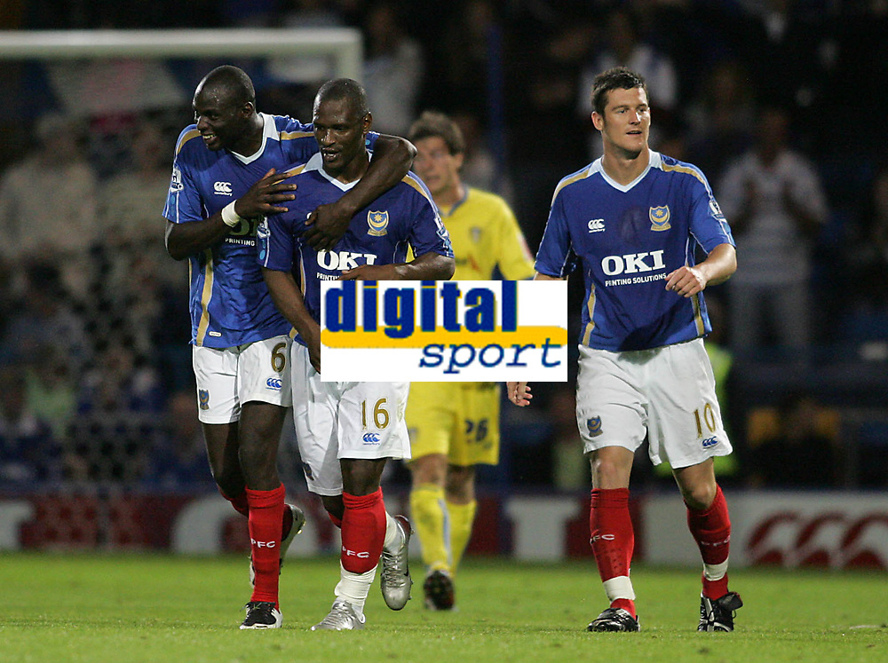Photo: Lee Earle.<br /> Portsmouth v Leeds United. Carling Cup. 28/08/2007.Portsmouth's Djimi Traore (L) congratulates Noe Pamarot (C) after he scored their second.