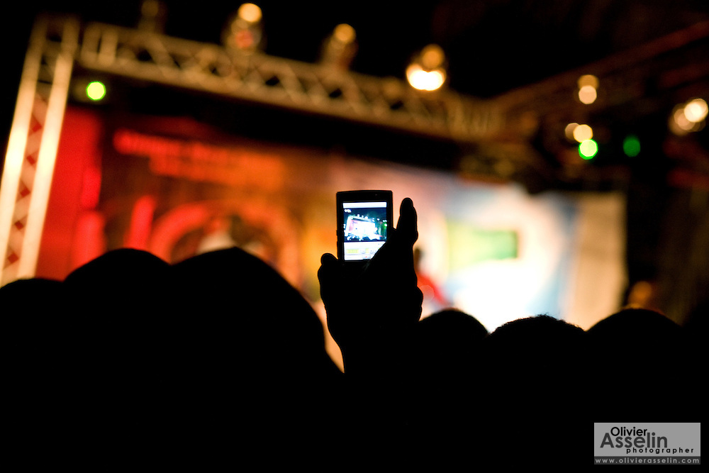 A reveler records a musical performance on his cell phone during a show held on the occasion of the annual Oguaa Fetu Afahye Festival in Cape Coast, Ghana on Saturday September 6, 2008.