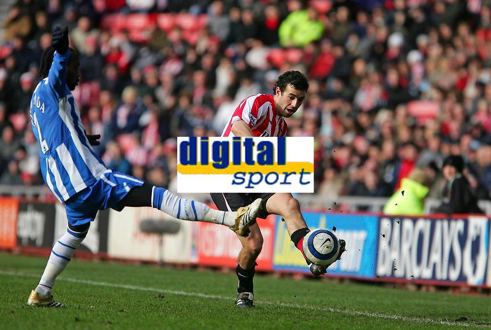 Photo: Andrew Unwin.<br />Sunderland v Wigan Athletic. The Barclays Premiership. 11/03/2006.<br />Sunderland's Julio Arca (R) plays the ball past Wigan's Pascal Chimbonda (L).