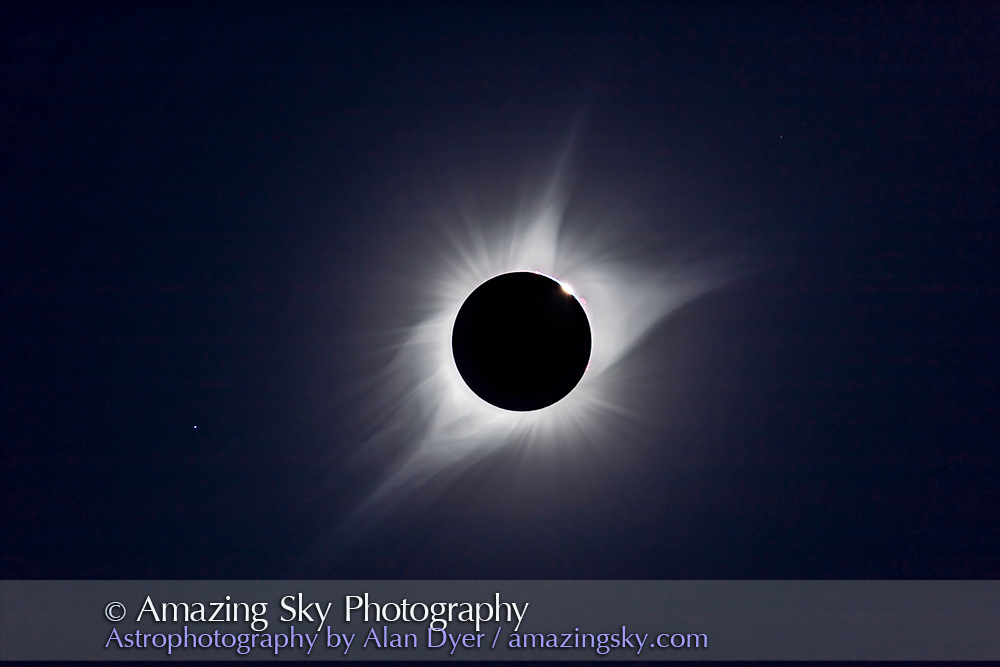 A composite of the August 21, 2017 total solar eclipse showing third contact &ndash; the end of totality &ndash;&nbsp;with sunlight beginning to reappear and the array of pink prominences along the limb of the Sun. Seconds later the emerging Sun and diamond ring overwhelmed the large prominence. <br /> <br /> Regulus is at lower left. <br /> <br /> This is a composite of two images taken seconds apart: a 1/15th second exposure for the corona and a 1/1000 sec exposure for the prominences and chromosphere. Taken with the 106mm Astro-Physics apo refractor at f/5 and Canon 6D MkII camera at ISO 100. On the Mach One equatorial mount, polar aligned and tracking the sky.