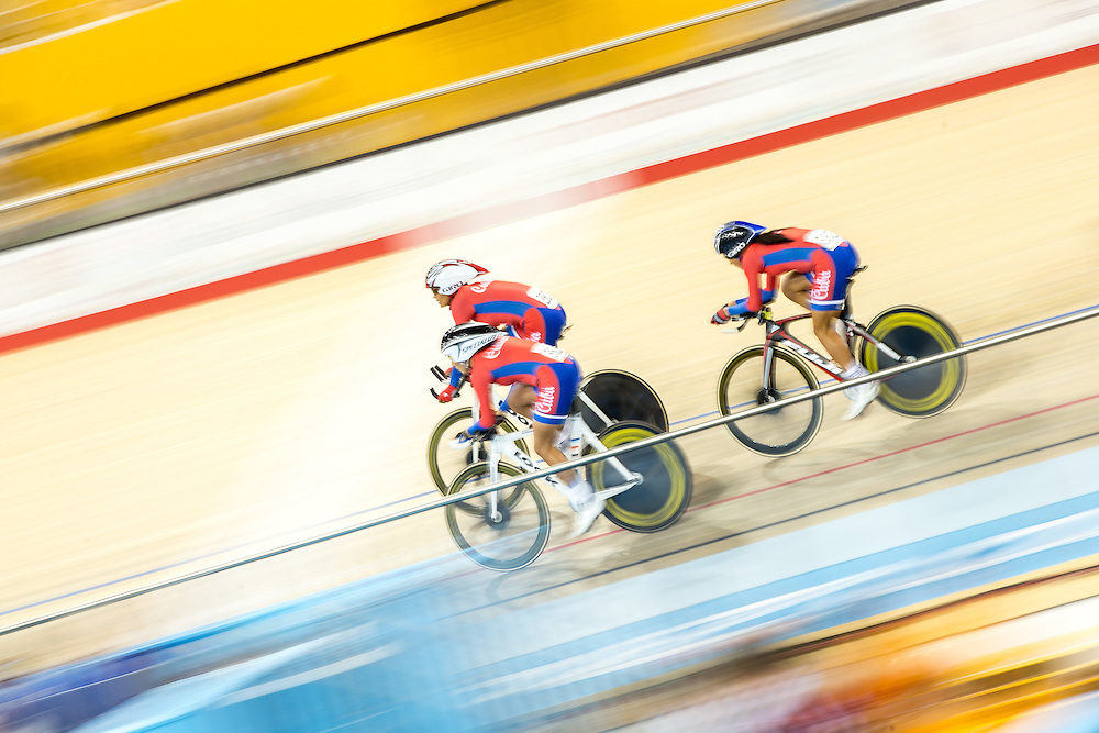 Cuba's team of (L-R) Yeima Torres,<br /> Yumari Gonzalez and Arlenis Sierra race in the women's cycling team pursuit at the 2015 Pan American Games in Toronto, Canada, July 17,  2015.  AFP PHOTO/GEOFF ROBINS