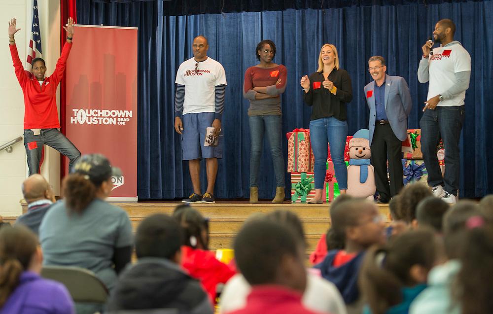 Chameka Scott, Ellis Wyms, Abiloa Wabara, Kami Craig, Lewis Senior and Wade Smith talk with students during a Touchdown Houston Read On literacy program at Ross Elementary School, December 2, 2016.