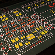 Close up of Craps with betting odds on table inside casino in Atlantic City, NJ.