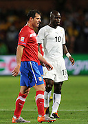 Dejan Stankovic (Serbia) and Stephen Appiah (Ghana) during the 2010 FIFA World Cup South Africa Group D match between Serbia and Ghana at Loftus Versfeld Stadium on June 13, 2010 in Pretoria, South Africa.