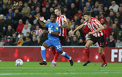 Siriki Dembele of Peterborough United takes on Chris Maguire and Tom Flanagan of Sunderland - Mandatory by-line: Joe Dent/JMP - 02/10/2018 - FOOTBALL - Stadium of Light - Sunderland, England - Sunderland v Peterborough United - Sky Bet League One