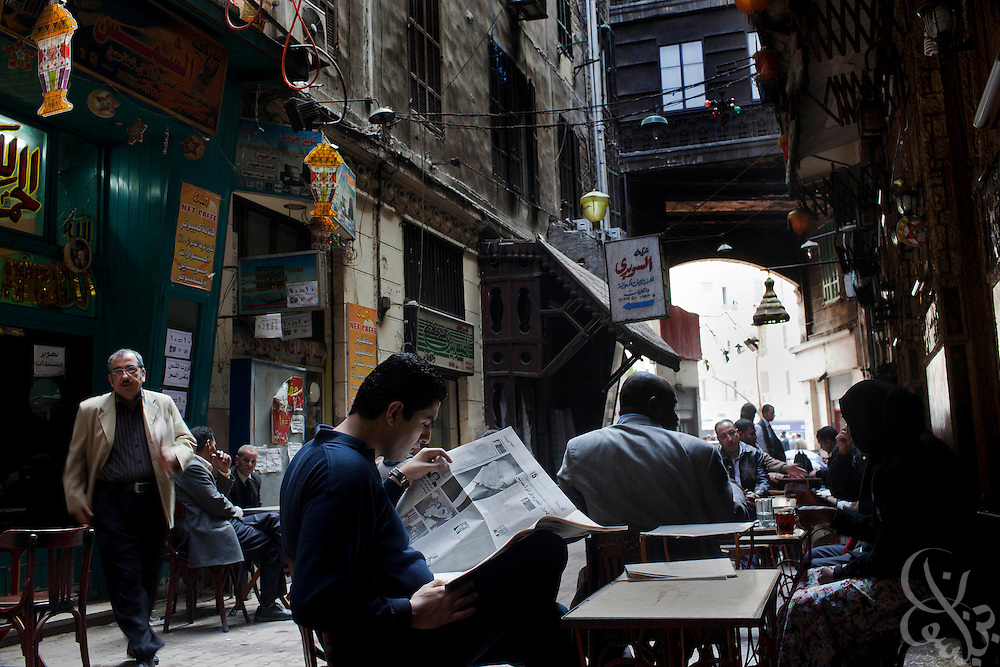 Egyptians take advantage of a day of relative calm to read newspapers and sip tea at an alley cafe January 27, 2011 in Cairo, Egypt following two days of  clashes between protesters intent on bringing down the Hosni Mubarak government. Despite the one day lull, even larger demonstrations than those that have occurred are planned by opposition groups following afternoon prayers on Friday..Slug: Egypt.Credit: Scott Nelson for the New York Times