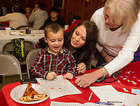 Jayden Doucette can't control his excitement to see Santa Claus with Kerstyn Flack and Linda Ainsworth at the VFW Christmas party on Saturday afternoon.  (Karen Bobotas/for the Laconia Daily Sun)