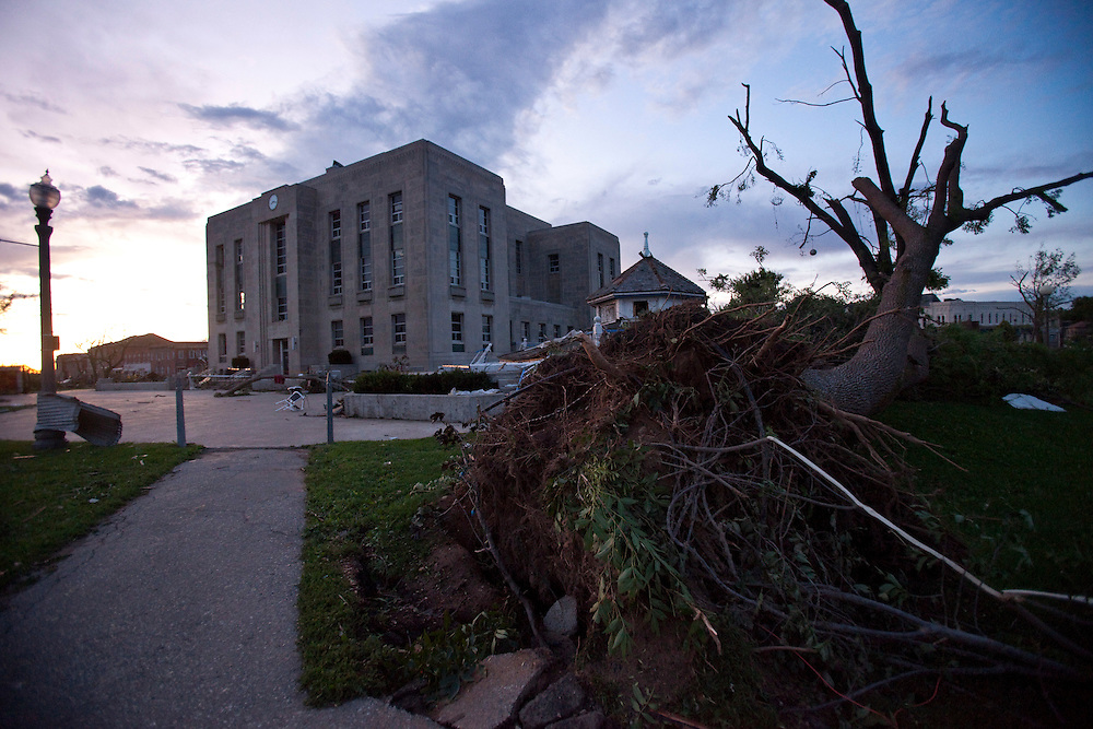 An uprooted tree sits in front of the courthouse after a Tornado caused significant damage to the downtown core of Goderich Ontario, Sunday, August 21, 2011.<br /> THE CANADIAN PRESS/ Geoff Robins