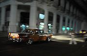 Havana, Cuba 111609   A  classic vintage American car makes its way down the street in old Havana in Havana Cuba. (Essdras M Suarez/ EMS Photography).