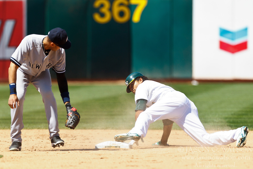 OAKLAND, CA - JULY 22: Coco Crisp #4 of the Oakland Athletics steals second base ahead of a tag from Derek Jeter #2 of the New York Yankees during the eighth inning at O.co Coliseum on July 22, 2012 in Oakland, California.  (Photo by Jason O. Watson/Getty Images) *** Local Caption *** Coco Crisp; Derek Jeter