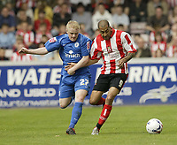 Photo: Aidan Ellis.<br /> Lincoln City v Rochdale. Coca Cola League 2. 06/05/2006.<br /> Lincoln's Francis Green battles with Rochdale's John Doolan