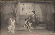Male actor dressed as a woman, a boy in a monkey costume with other actors dressed as a rabbit and a bear. Imperial Theater, Tokyo, Jan. 1915, collotype postcard, Yabuki Takanao Kosho-do Sei publisher.<br />