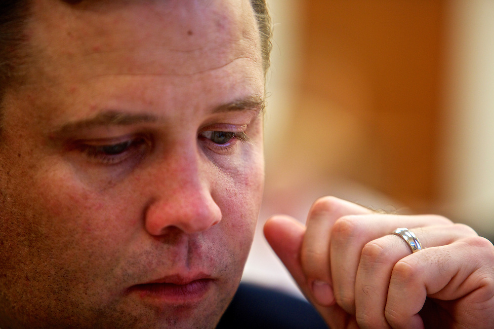 Congressman-elect Jim Bridenstine, from Oklahoma's First District, center, makes decisions about his future office, in the Rayburn House Office Building in Washington, DC on Nov. 30, 2012.