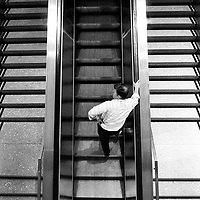 A man on an escalator