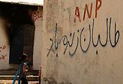 """Long live the Taliban"" is painted on a wall in a minority Christian area near Khuda Ki Basti, Taiser Town in Karachi, Pakistan."