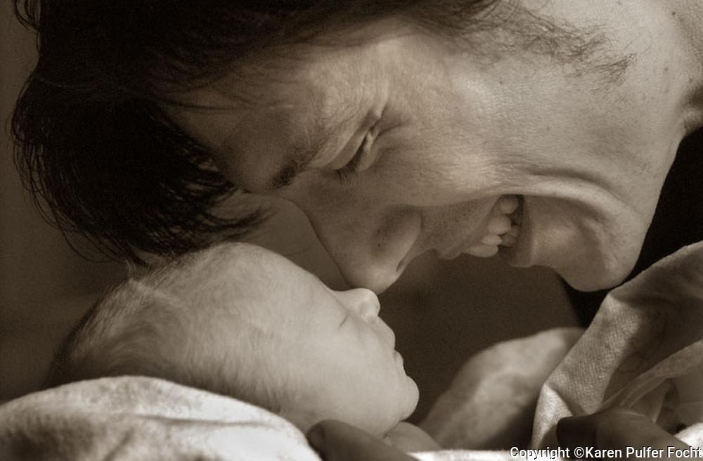 Bill Jackson, a new father, enjoys his newborn son, Elijah.