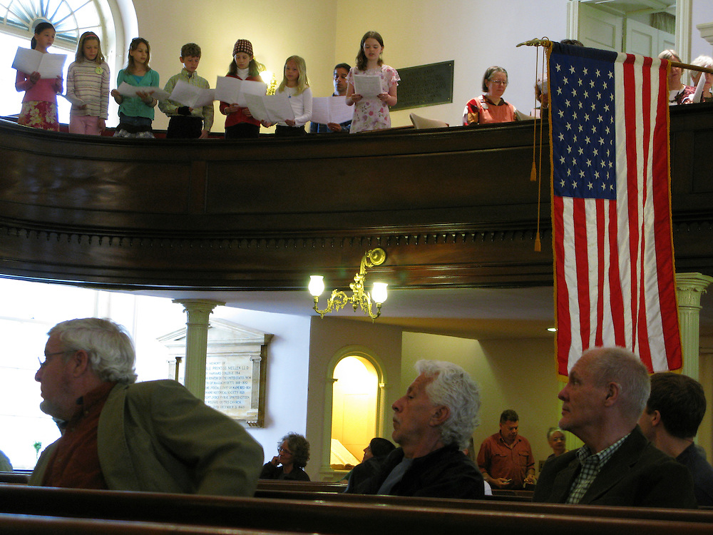 American flag hanging in a unitarian church in Portland, Maine during the singing of the choir.
