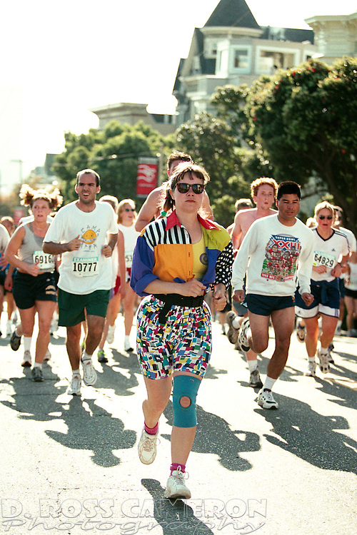 Runners top the crest of Hayes Street hill at the 89th annual Bay to Breakers 12K race, Sunday, May 21, 2000 in San Francisco. (Photo by D. Ross Cameron)