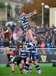 Bath second row Ryan Caldwell rises high to win lineout ball - Photo mandatory by-line: Patrick Khachfe/JMP - Tel: Mobile: 07966 386802 19/10/2013 - SPORT - RUGBY UNION - Recreation Ground - Bath - Bath V Newport Gwent Dragons - Amlin Challenge Cup