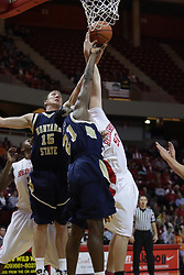 04 December 2010: Bobby Howard, Jordan Allou and Blake Mishler all get tangled together attempting a rebound during an NCAA basketball game between the Montana State Bobcats and the Illinois State Redbirds at Redbird Arena in Normal Illinois.