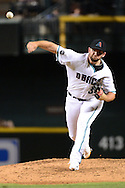 PHOENIX, AZ - JULY 05:  Jake Barrett #33 of the Arizona Diamondbacks delivers a pitch during the sixth inning against the San Diego Padres at Chase Field on July 5, 2016 in Phoenix, Arizona.  (Photo by Jennifer Stewart/Getty Images)