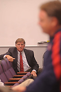 """Ole Miss athletic director Pete Boone listens as head coach football coach Houston Nutt speaks about the football program during a press conference in Oxford, Miss. on Monday, Sept. 19, 2011. Ole Miss has started the season 1-2, including a 30-7 loss to Vanderbilt on Saturday, Sept. 17, 2011 that Boone termed """"unacceptable."""""""