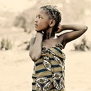 Beautiful African girl wearing traditional village garment.