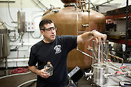 Head Brewer/Head Distiller Yuseff Cherney leads a tour group through Ballast Point Brewing Company's headquarters as part of the San Diego Science Festival, March 21, 2011.