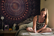 TUSCALOOSA, AL – SEPTEMBER 28, 2016: Freshman Brianna Zavolowitz takes a few moments to study in her dorm room before class. A native of Staten Island, Zavolowitz came to the University of Alabama on full scholarship as an out of state student. Despite the rising cost of college tuition nationwide, in state student enrollment is becoming less profitable for major public universities. In response to these financial shortfalls, flagship universities around the country are working hard to rebrand themselves as attractive institutions for out of state students. The University of Alabama has begun an aggressive campaign to recruit out of state students, as the revenue from those students is much greater. CREDIT: Bob Miller for The New York Times